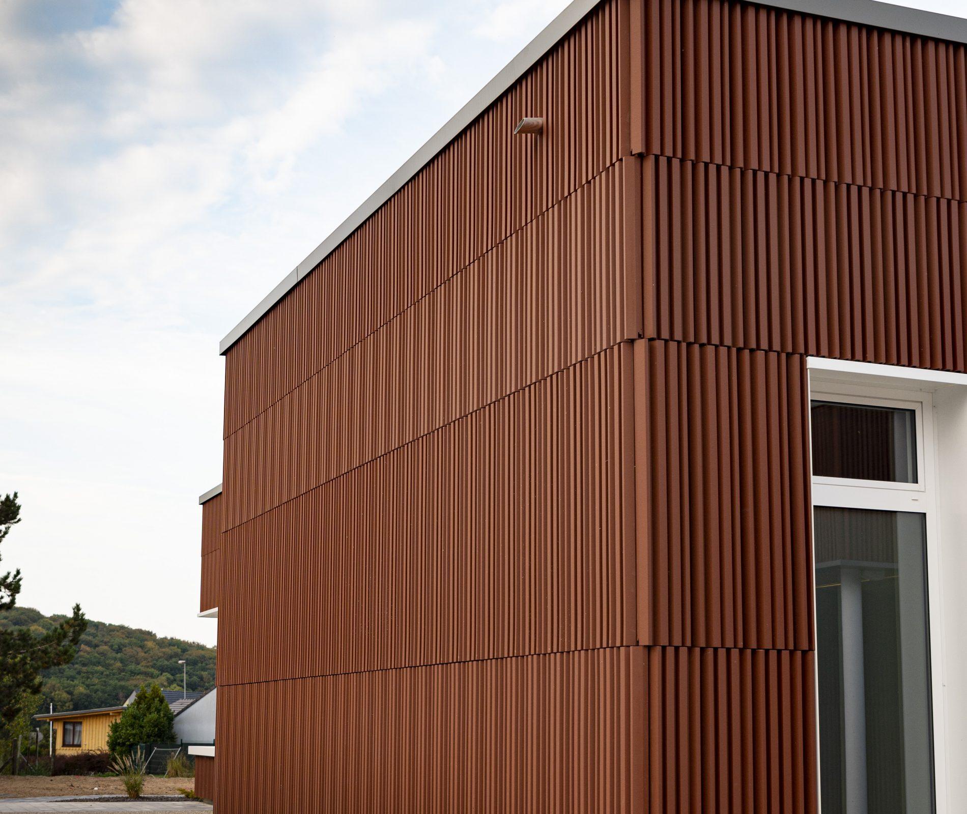 Travaux de façade sur béton de l'école Les Grands Cèdres à Rosbruck Metz en Moselle